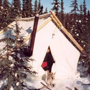 Durable canvas wall tent with stove pipe coming from front