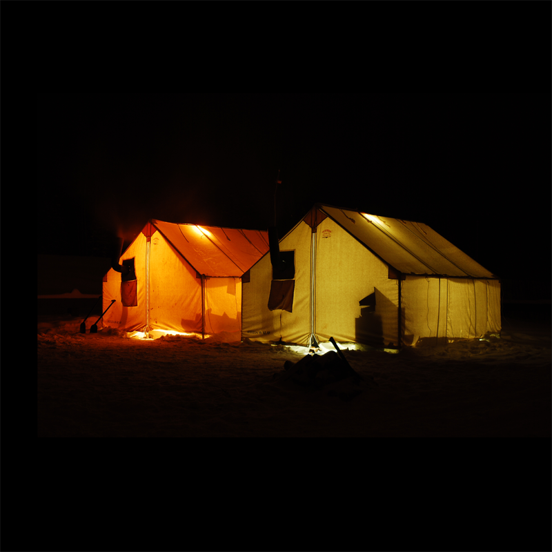 Canvas Wall Tents Glowing in the Arctic